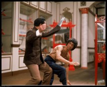 Medium BTS shot of Shih Kien as Han, wearing razor hand. And Bruce Lee as Lee rehearsing fight scene. PHOTOGRAPHS TO BE USED SOLELY FOR ADVERTISING, PROMOTION, PUBLICITY OR REVIEWS OF THIS SPECIFIC MOTION PICTURE AND TO REMAIN THE PROPERTY OF THE STUDIO. NOT FOR SALE OR REDISTRIBUTION. ALL RIGHTS RESERVED.