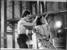 Bruce Lee puts Jackie Chan in headlock. Promotional still from History's new special, How Bruce Lee Changed the World
