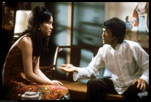 Medium profile shot of Bruce Lee as Lee talking to Betty Chung as Mei Ling, both seated PHOTOGRAPHS TO BE USED SOLELY FOR ADVERTISING, PROMOTION, PUBLICITY OR REVIEWS OF THIS SPECIFIC MOTION PICTURE AND TO REMAIN THE PROPERTY OF THE STUDIO. NOT FOR SALE OR REDISTRIBUTION. ALL RIGHTS RESERVED.