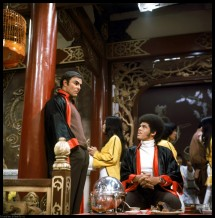 Full shot of John Saxon as Roper talking to seated Jim Kelly as Williams, both wearing robes PHOTOGRAPHS TO BE USED SOLELY FOR ADVERTISING, PROMOTION, PUBLICITY OR REVIEWS OF THIS SPECIFIC MOTION PICTURE AND TO REMAIN THE PROPERTY OF THE STUDIO. NOT FOR SALE OR REDISTRIBUTION. ALL RIGHTS RESERVED.